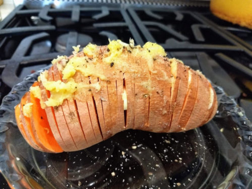 Preparing the hasselback potato